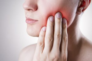 Pain from growing wisdom tooth